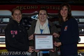 Ms. Dallas Gage, center, presents the FM Global Fire Prevention Grant Award to Fire Lieutenant/Fire Prevention Officer Heather Bean  left and Stephanie Boyd, right.
